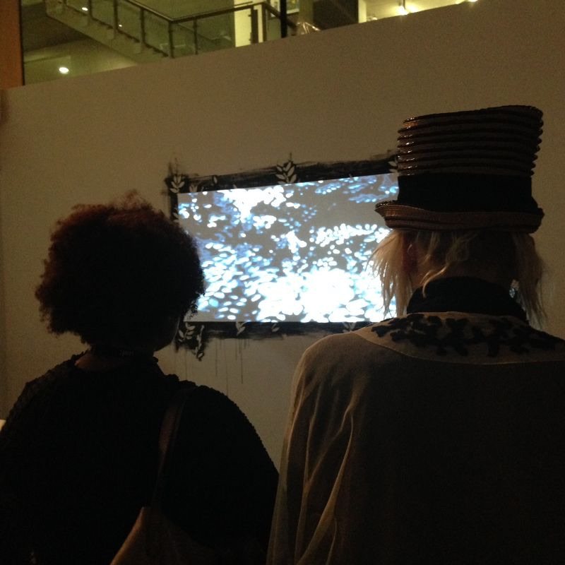 Checking out one of the four audiovisual installations at the exhibition